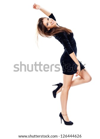 happy woman in black dress on heels with one hand up, isolated - stock photo