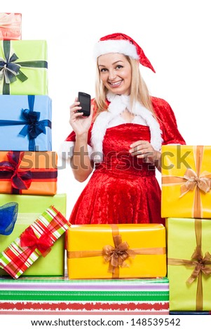 Happy woman in Christmas costume with phone and many presents, isolated on white background.
