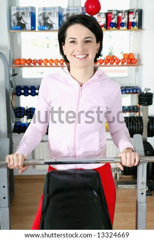 happy woman in fitness studio