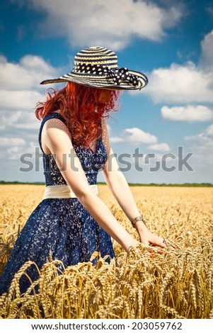 Happy woman in golden wheat in summer time. Serbia. - stock photo