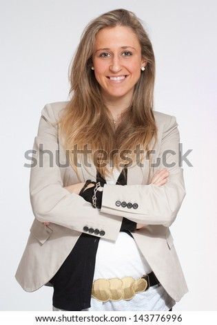 Happy woman in her early stages of pregnancy - stock photo