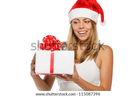 Happy woman in Santa hat holding a Xmas gift, isolated on white background - stock photo