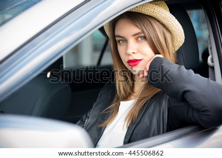 happy woman in summer hat driving car outdoors - stock photo