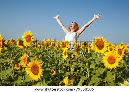 happy woman in sunflower field - stock photo