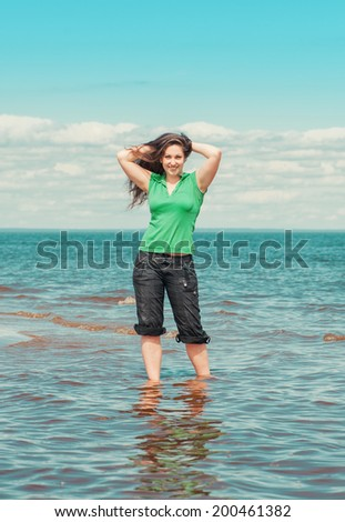 Happy woman in the water of sea - stock photo