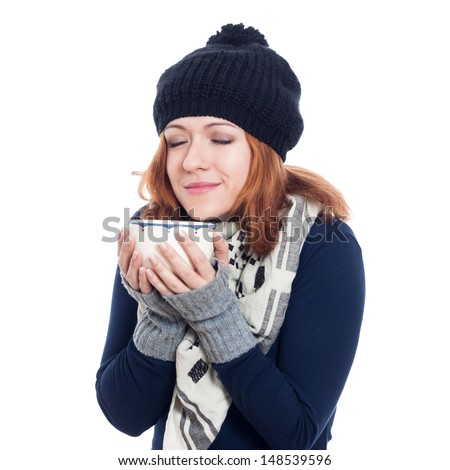 Happy woman in winter clothes enjoying hot drink, isolated on white background. - stock photo