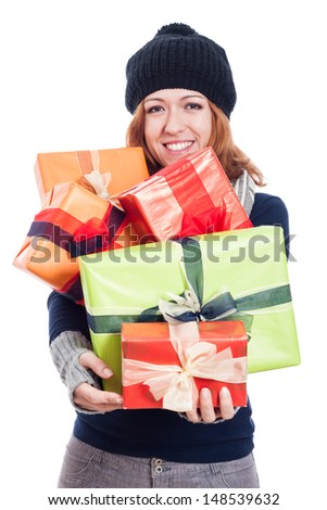 Happy woman in winter clothes holding many presents, isolated on white background. - stock photo
