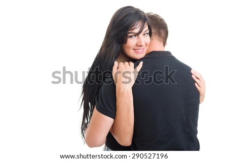 Happy woman inlove hugging man or boyfriend on white studio background - stock photo