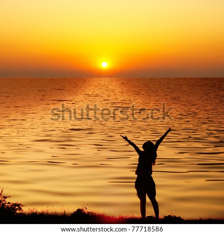 Happy woman jump and sunset silhouette in Lake - stock photo