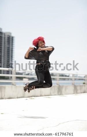 Happy woman jumping for joy - stock photo