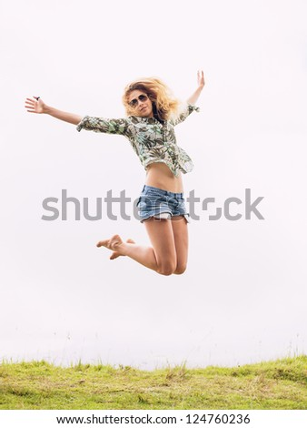 Happy woman jumping into the clouds
