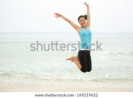 Happy woman jumping on the beach. summer holidays - stock photo