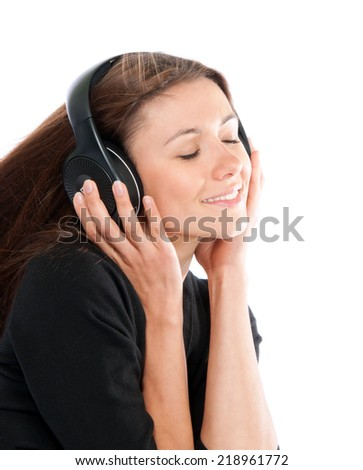 Happy woman listening and enjoy music in headphones smiling eyes closed  isolated on a white background - stock photo