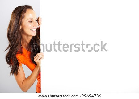 happy woman looking at white board - stock photo