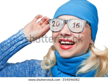 Happy woman looking into the distance in sporty blue cap with the inscription on the glasses 2016 - stock photo