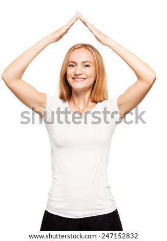 Happy woman made a roof over your head. Security - stock photo