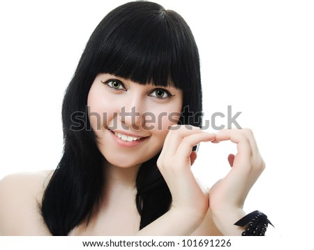 Happy woman make heart shape by her hands, closeup portrait on white background.