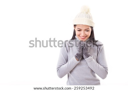 happy woman making a wish or praying in fall or winter - stock photo