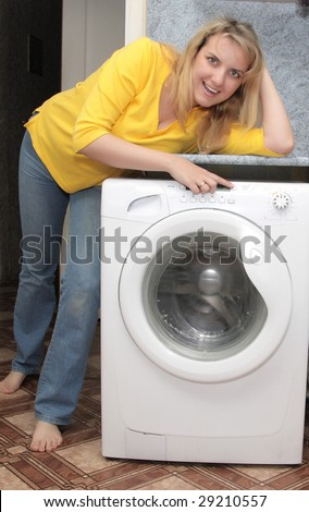 happy woman near washing machine