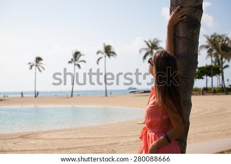 Happy woman on beach enjoying nature. Natural beauty girl outdoor in freedom enjoyment concept. Summer luxury vacation. Hawaiian Island of Oahu - stock photo