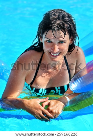 Happy woman  on inflatable beach mattress.