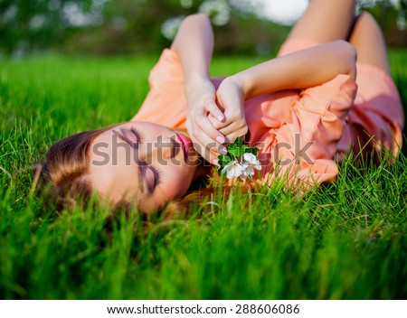 happy woman on the grass in the summer park - stock photo