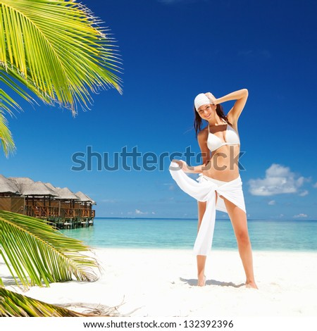 Happy woman on the tropical beach - stock photo