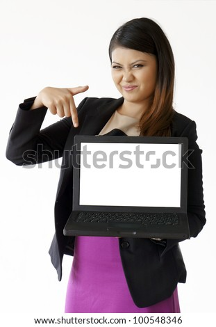 Happy woman pointing at a laptop screen - stock photo