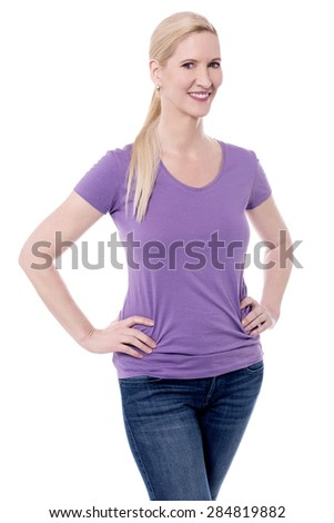 Happy woman posing with hands in her waist