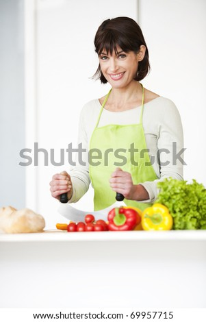Happy Woman Preparing Meal