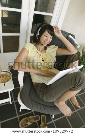 Happy woman receives a video call over the Internet - stock photo