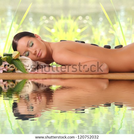 happy woman relaxing in spa - stock photo