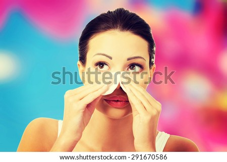 Happy woman removing make up - stock photo