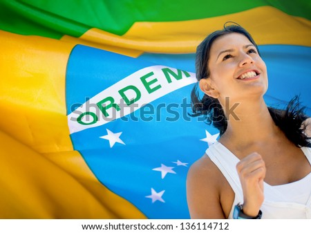 Happy woman running a marathon in Brazil