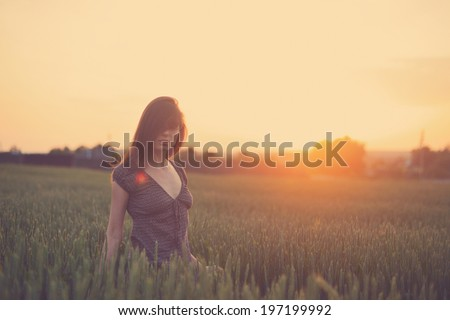 Happy woman running in the green field - stock photo