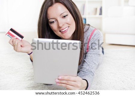 Happy woman shopping on line