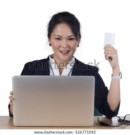 Happy woman shopping online paying with credit card - Isolated on white background. Model is Asian woman. - stock photo