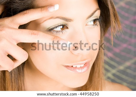 Happy woman show a sign with fingers