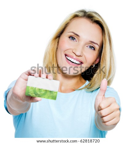 happy woman showing thumbs-up with credit card on white bacground - stock photo
