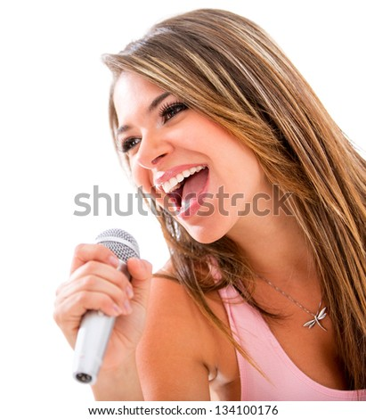 Happy woman singing with a microphone - isolated over a white background - stock photo