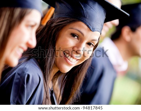 Happy woman smiling in her graduation day - stock photo