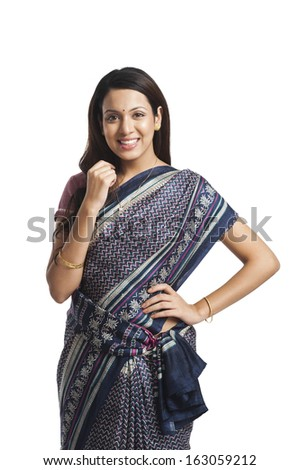 Happy woman standing with her hand on hip - stock photo