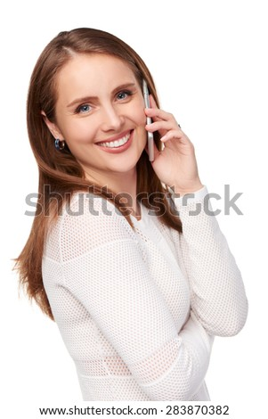 Happy woman talking on cell phone, over white background - stock photo