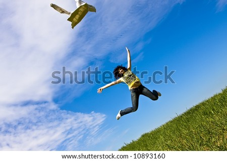 Happy woman throwing her jacket to the air. - stock photo