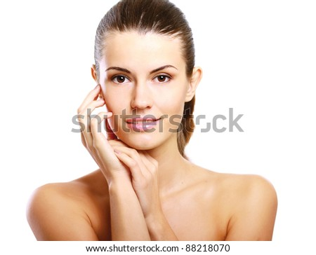 Happy woman touching hr face isolated