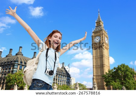 Happy woman travel in London with Big Ben tower, caucasian beauty - stock photo