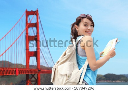 Happy woman travel in San Francisco and look map, asian - stock photo