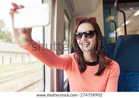Happy woman traveler taking photo. - stock photo