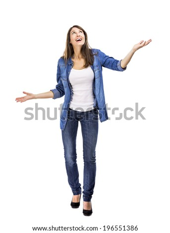 Happy woman trying to catch something falling from the sky - stock photo