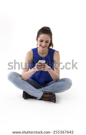 Happy Woman using a Smart Phone. Isolated over a white background - stock photo